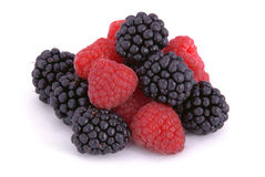 Raspberries and blackberries. On white background Royalty Free Stock Images