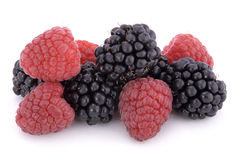 Raspberries and blackberries. On white background Royalty Free Stock Photos