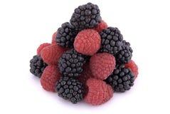 Raspberries and blackberries. On white background Stock Image