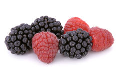 Raspberries and blackberries. On white background Stock Images