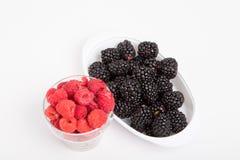 Raspberries and Blackberries on White. Fresh, whole fruit on a white background. Raspberries and Blackberries on White Stock Image
