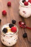 Raspberries and blackberries with yoghurt Royalty Free Stock Photo