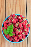 Raspberries in the blue bowl Royalty Free Stock Image
