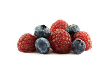 Raspberries and Blueberries. Photo of raspberries and blueberries isolated on a white background Stock Images