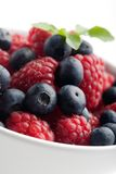Raspberries and blueberries Royalty Free Stock Images