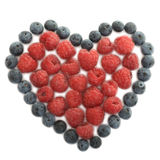 Raspberries, blueberries. Fresh raspberries and blueberries illustrated as a heart Royalty Free Stock Photo