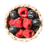 Raspberries And Blueberries. In Basket Isolated Royalty Free Stock Photos