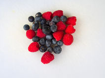 Raspberries & Blueberries. Berries on the white background Royalty Free Stock Photo