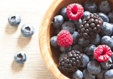 Raspberries blueberries and blackberries in a bowl Royalty Free Stock Photography