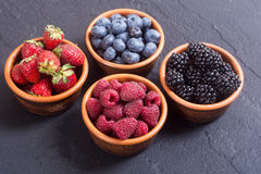Raspberries , blueberries , blackberries , strawberries. Berries : raspberries, blueberries blackberries strawberries in a bowl Royalty Free Stock Photo