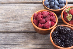 Raspberries , blueberries , blackberries , strawberries. Berries : raspberries , blueberries , blackberries , strawberries in a bowl . space for text Stock Photos