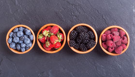 Raspberries , blueberries , blackberries , strawberries. Berries : raspberries , blueberries , blackberries , strawberries in a bowl . Top view Royalty Free Stock Photo