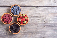 Raspberries , blueberries , blackberries , strawberries. Berries : raspberries , blueberries , blackberries , strawberries in a bowl . Top view space for text Stock Images