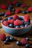 Berries in a blue bowl Royalty Free Stock Photography