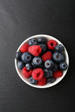 Raspberries and blueberries in a bowl. Food Stock Photography