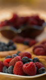 Raspberries and Blueberries With Danish Pastries Royalty Free Stock Image