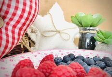 Raspberries and blueberries in the dish. royalty free stock images