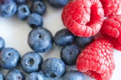 Raspberries and blueberries. Fruit raspberries and blueberries background Stock Images