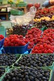 Raspberries and blueberries at a market Royalty Free Stock Images