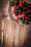 Raspberries and blueberries on a plate in the Oriental style Stock Photo