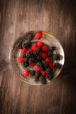Raspberries and blueberries on a plate in the Oriental style Royalty Free Stock Image