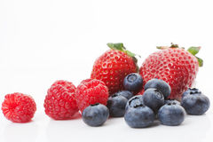 Raspberries, blueberries and strawberries. Blueberries, raspberries and strawberries over white background. Sweet summer fruits stock photos