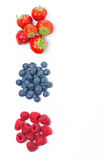 Raspberries, blueberries and strawberries, top view, isolated. On white Stock Images