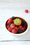 Raspberries, blueberries and strawberry in a bowl. Healthy food Royalty Free Stock Images