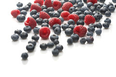 Raspberries and blueberries on white background Royalty Free Stock Photo