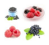 Raspberries and blueberries on white background. Fruit smoothie. Royalty Free Stock Image