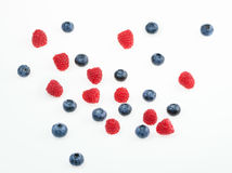 Raspberries and blueberries on white background.  top view Stock Photo