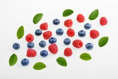 Raspberries and blueberries on white background.  top view. Raspberries and blueberries on white background. top view Stock Image