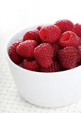 Raspberries in bowl - close-up Stock Photo