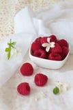 Raspberries in a bowl Stock Photo