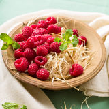 Raspberries in a bowl. With fresh mint Royalty Free Stock Photo