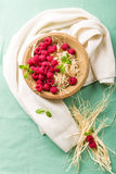Raspberries in a bowl. With fresh mint Royalty Free Stock Photography