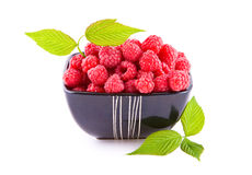 Raspberries in a bowl Stock Photo