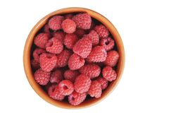 Raspberries in a bowl on a white background. Stock Photography