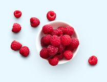 Bowl of raspberries isolated on white background. Raspberries in bowl isolated on white background, top view, cutout Royalty Free Stock Image