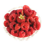 Raspberries in bowl isolated on white. Closeup Stock Image