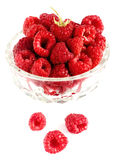 Raspberries in bowl isolated on white. Closeup Stock Photography