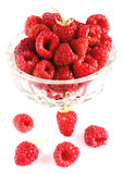 Raspberries in bowl isolated on white. Closeup Royalty Free Stock Photography