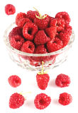 Raspberries in bowl isolated on white. Closeup Stock Photos