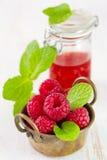 Raspberries in bowl Stock Image