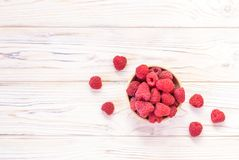 Raspberries bowl on rustic wood background, top view with copy s. Pace. Organic berries on wooden table Royalty Free Stock Photo