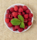 Raspberries in a bowl. On a table Stock Photo