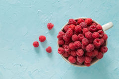 Raspberries in bowl, top view. Copy space Stock Photo