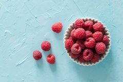 Raspberries in bowl, top view. Copy space Royalty Free Stock Photos