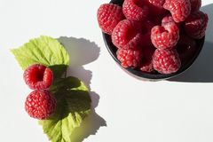 Raspberries bowl top view. With copy space on white background Stock Image
