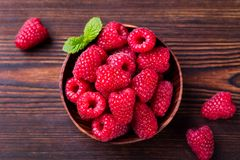 Raspberries in bowl on wooden table. Top view. Raspberries in bowl on wooden table. Top view Stock Photo